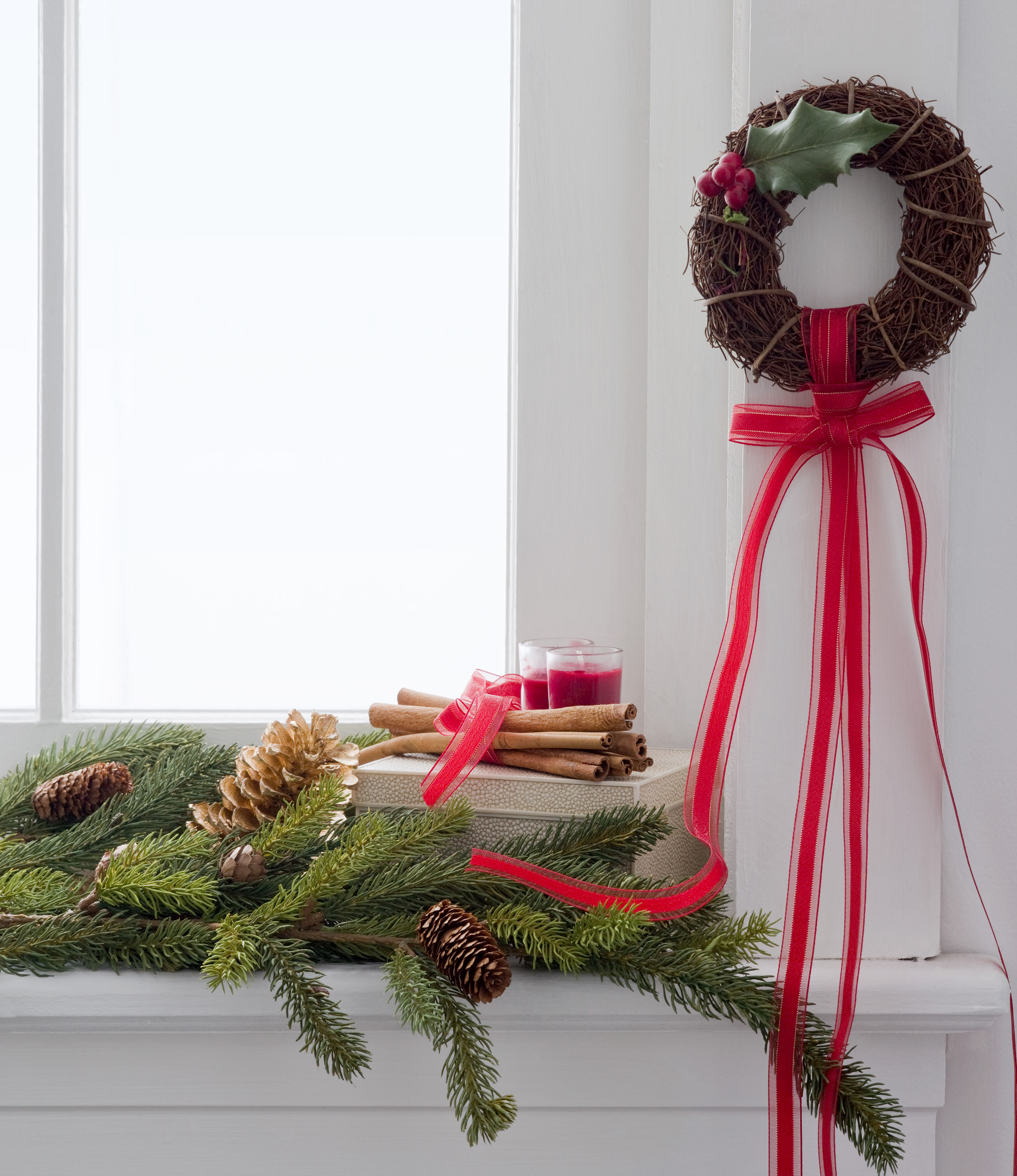 Christmas wreath and boughs on window sill