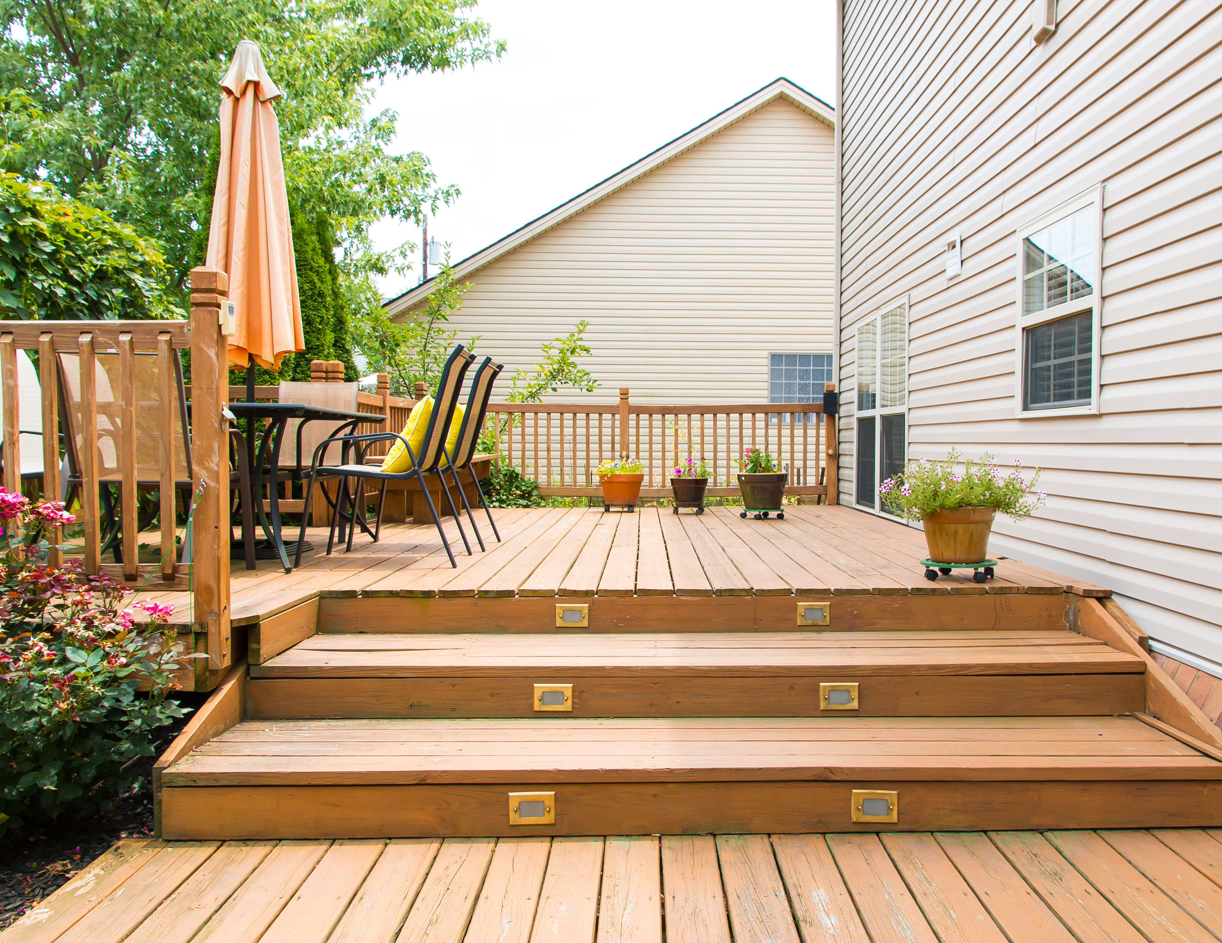 Modern wooden patio and garden area of a family house